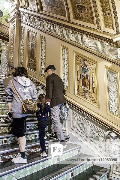United Kingdom Great Britain England  London  Knightsbridge  Victoria and & Albert Museum V&A V & A  inside interior  ceramic staircase  designed by Francis Wollaston Moody  ornate  man  woman  girl  family  climbing