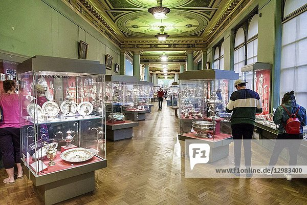 United Kingdom Great Britain England  London  Knightsbridge  Victoria and & Albert Museum V&A V & A  museum  inside interior  glass display cases  dining tableware  Silver galleries  man  woman