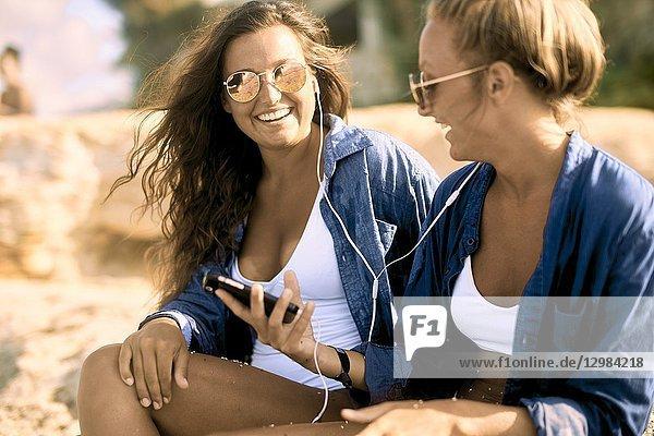 Two women at beach  Chersonissos  Crete  Greece.