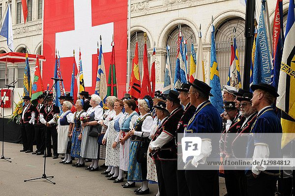 Male and female chorus of a swiss folklore group at the national day parade in Zürich-city.