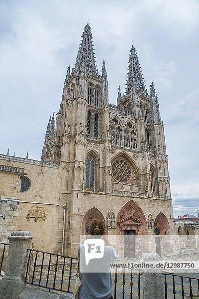 Tourist taking photos of the cathedral. Burgos  Spain.