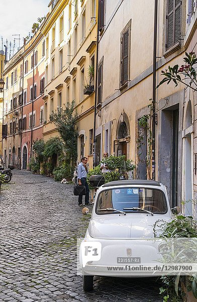 Old Fiat 500 car and colourful old houses in the Trastevere district of Rome  central Italy.