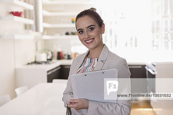 Portrait smiling  confident female real estate agent