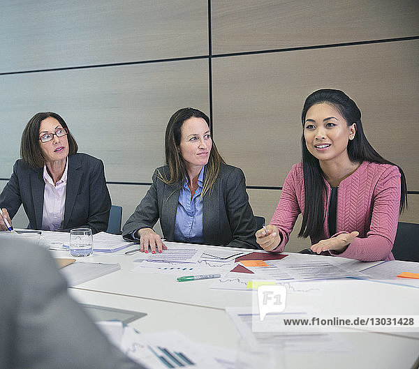 Businesswoman talking in conference room meeting