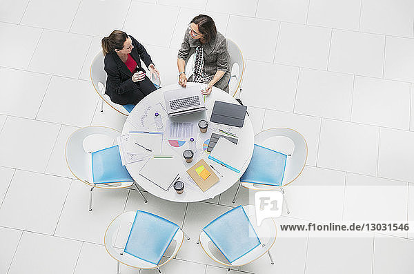 High angle view businesswomen talking  meeting at round table