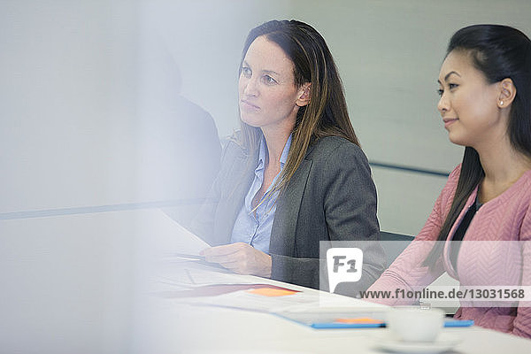 Attentive businesswoman listening in conference room meeting