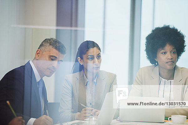 Focused business people in conference room meeting