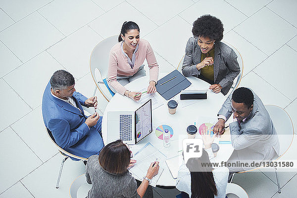 High angle view business people meeting at round table