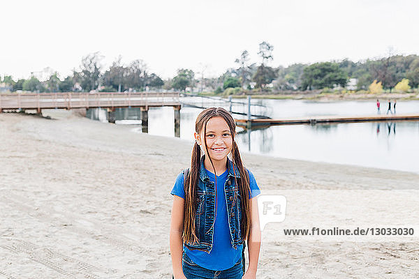 Girl on sandy beach  Long Beach  California  US