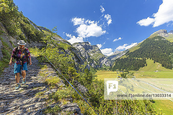 A hiker walks along the path called Scala Mola  Val Bargis valley  Flims  District of Imboden  Canton of Grisons (Graubunden)  Switzerland