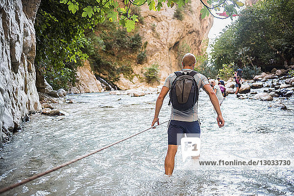 Tourist hiking in Saklikent Gorge  Saklikent National Park  Fethiye Province  Lycia  Anatolia  Turkey Minor