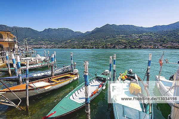 Boats moored at Monte Isola  the largest lake island in Europe  Province of Brescia  Lombardy  Italy