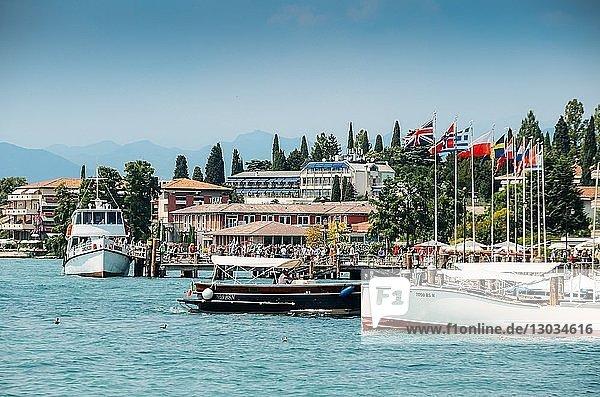 Busy marina and ferry terminal at Sirmione  Lake Garda  Lombardy  Italian Lakes  Italy