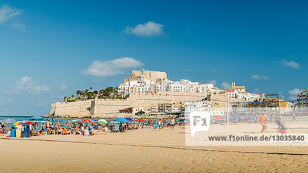 Crowded beach and the medieval fort town of Peniscola  Castellon  Spain
