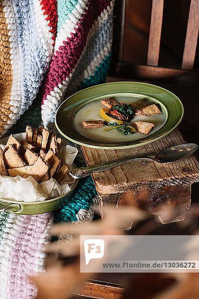 Bowl of fresh food on rustic kitchen table