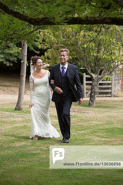 Father walking daughter to wedding
