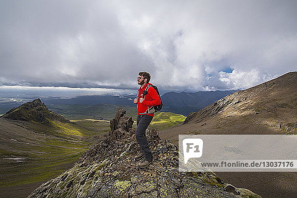 Side view shot of a male hiker standing in Skaftafell National park  Iceland
