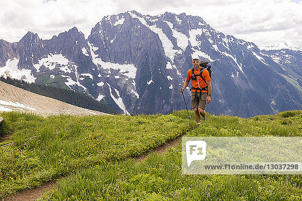A man approaching the West Ridge of Mount Forbidden  North Cascades National Park  Marblemount  Washington State USA
