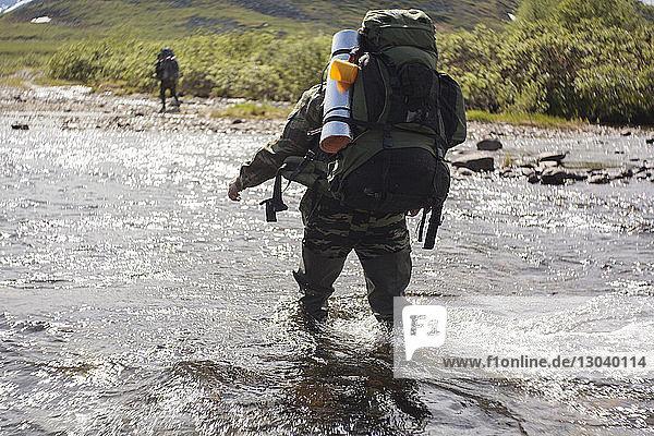 Hiker walking in river
