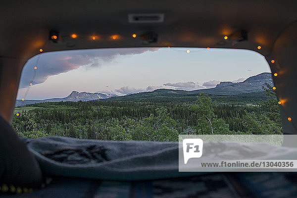 Scenic view of Glacier National Park seen through sports utility vehicle