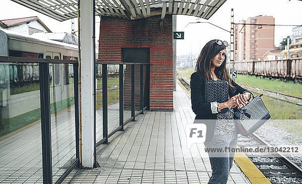 Woman waiting for train at station