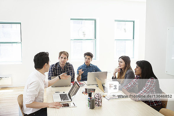 Business people discussing in board room at creative office