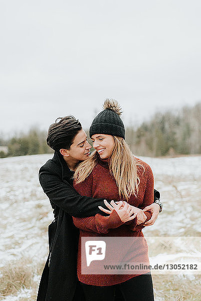 Couple hugging in snowy landscape  Georgetown  Canada