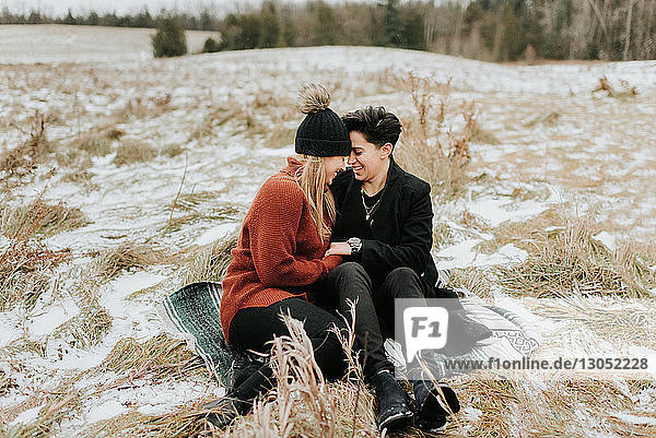 Couple sitting on blanket on frozen ground  Georgetown  Canada