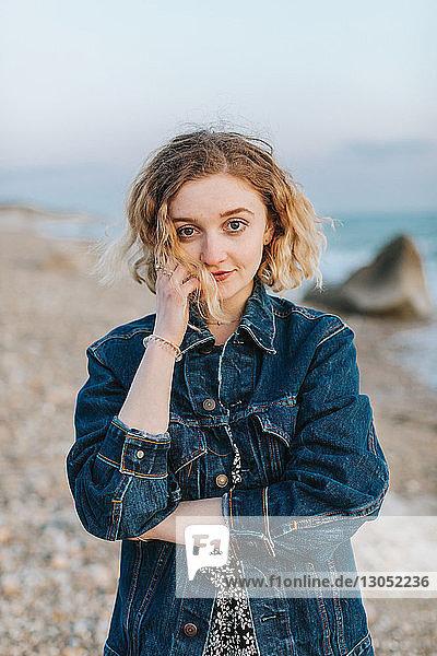 Blond haired young woman on beach  portrait  Menemsha  Martha's Vineyard  Massachusetts  USA
