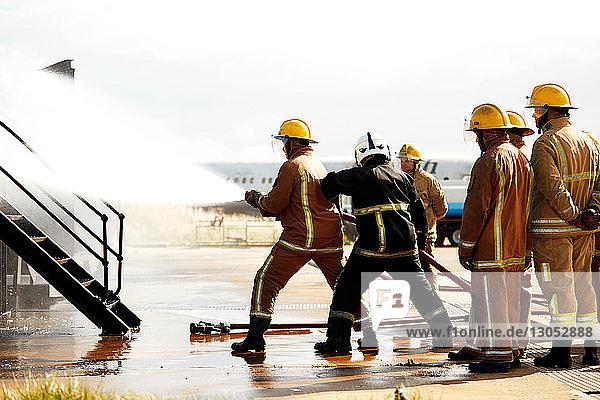 Firemen training  firemen spraying water at training facility