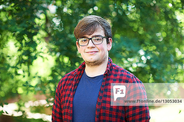 Young male higher education student on college campus  portrait