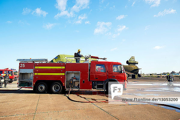 Firemen and fire engine in training centre  Darlington  UK