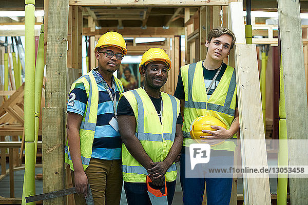 Three male higher education carpentry students in college workshop  portrait