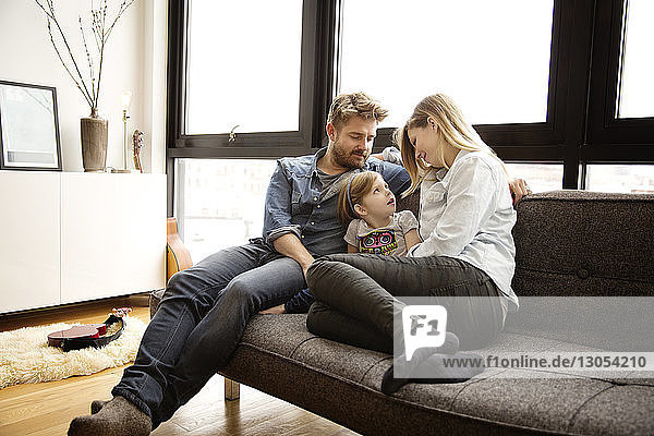 Family sitting on couch in living room