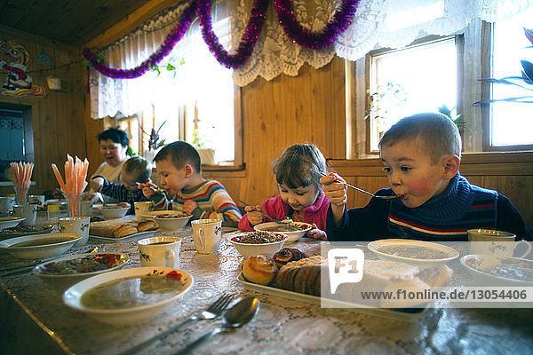 Family having breakfast at table