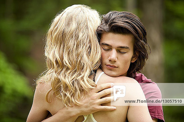 Rear view of woman embracing boyfriend