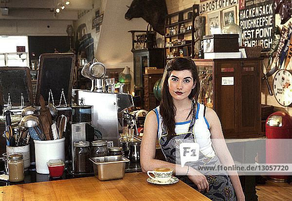 Portrait of female owner at cafe