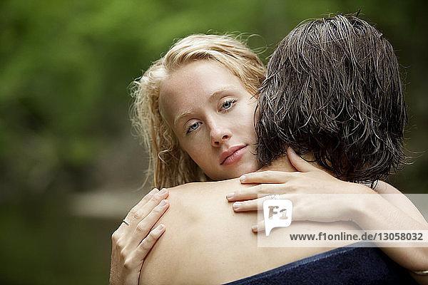 Portrait of woman embracing man
