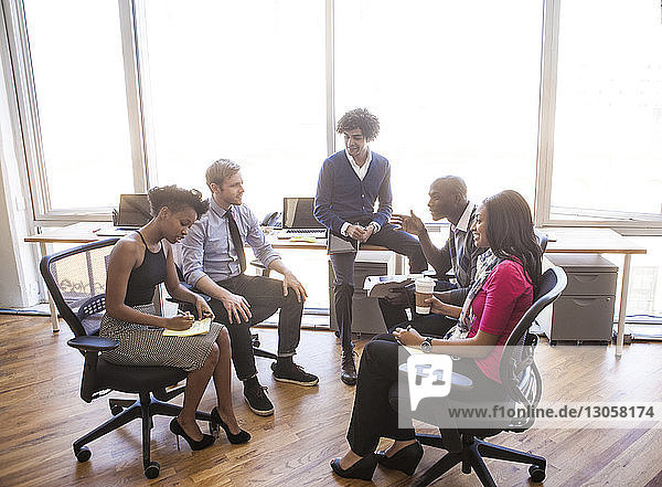 High angle view of business people in meeting at office