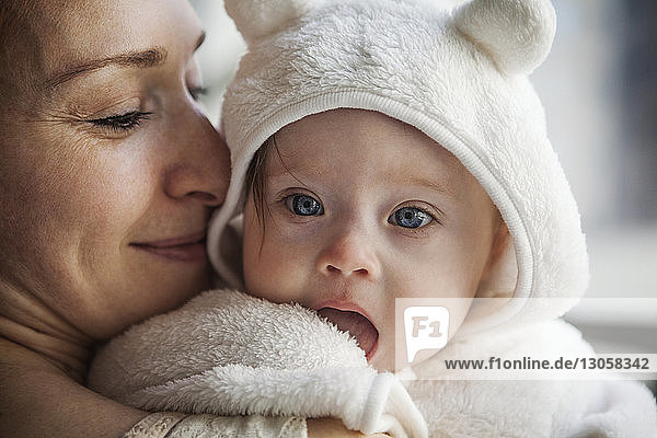 Close-up of mother carrying cute baby girl