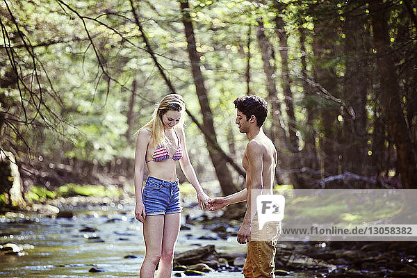 Couple standing in stream
