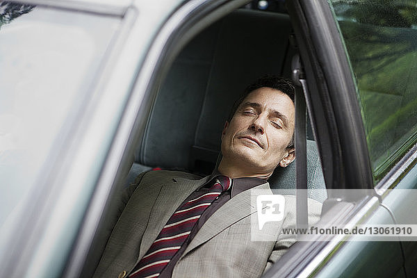 Man relaxing while sitting in car
