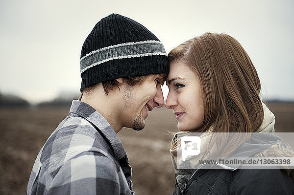 Close-up of smiling young couple looking at each other