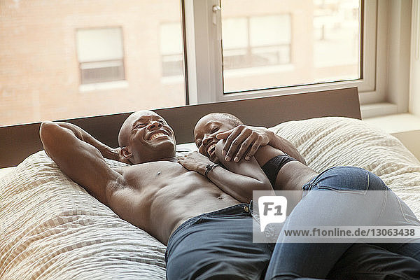 High angle view of couple on bed at home