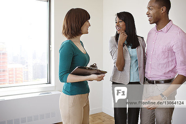 Happy colleagues talking in office