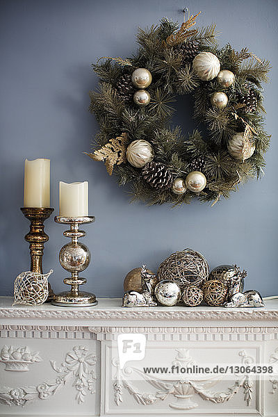 Christmas wreaths hanging on wall over mantelpiece
