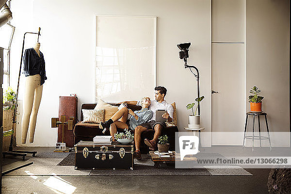 Happy couple having leisure time in living room at home