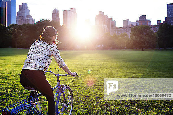 Rear view of woman cycling in Central Park