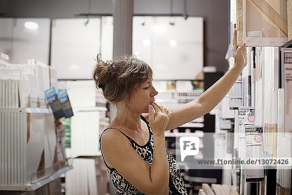 Woman shopping for tiles in mall