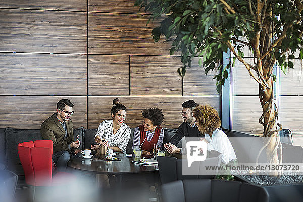 Business people discussing while at restaurant